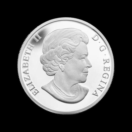 """Ein kanadischer Ureinwohner (Inuk), der, vor einem Iglu, einen frisch-geschnittenen Eisblock hochhebt und die Worte """"Canada 2014 10 Dollars""""."""