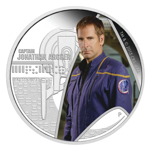 """Coin One: Colourized Captain Archer pictured in the Star Fleet insignia. Overhead view relief of the U.S.S. Enterprise NX-01 and the words """"Captain Jonathan Archer"""". Coin Two: A relief of the U.S.S. Enterprise NX-01 superimposed over a colourized planetar"""